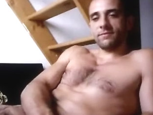 Pretty boy is having fun in his room and shooting himself on computer webcam