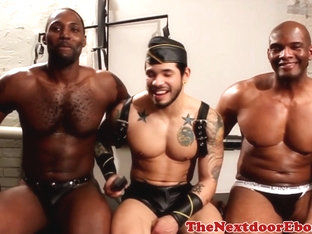 Leather ebony stud gets blowjob from hunk