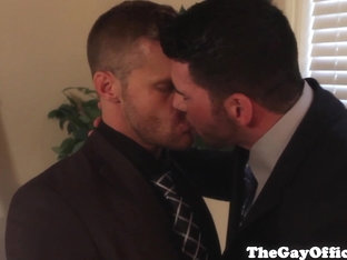 Suited hunk tastes colleagues jizz