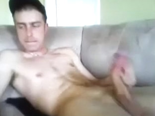 Attractive gay is relaxing within doors and filming himself on web cam