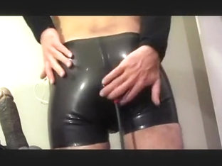 in latex fucking my arse with an inflatable sex-toy