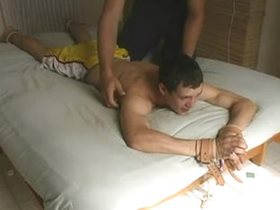 Guys Tickle Each Other on Bed