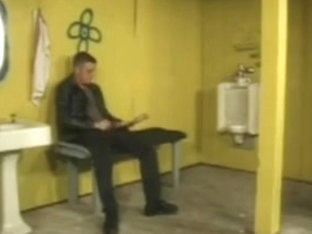 Two leather clad guys cruising in toilets