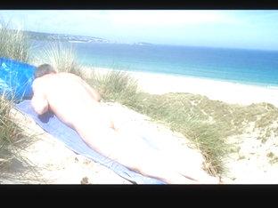 Male nudist spied massaging his butt  genitals in the dunes