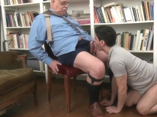 Playing with grandpa in the library