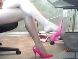 Dangling pink pump in pantyhose