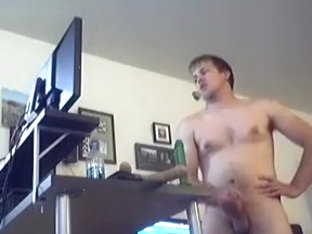 Attractive man is jerking off within doors and memorializing himself on web camera