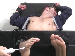 Bound and blindfolded hunk Sean Holmes endures feet tickling