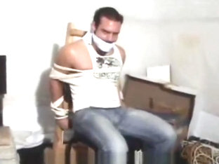 Mark Legnaro tied up and cleave gagged in tight jeans to a chair otm gagged
