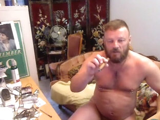 Bear smoking cigar, showing thick pierced cock