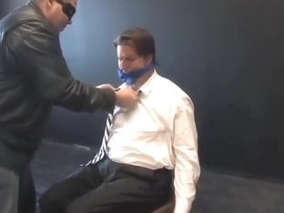 BG Hot beefy executive bound, gagged and stripped
