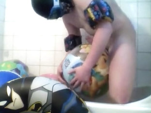 Fun in beach ball bath