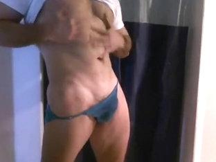 stripping to blue briefs