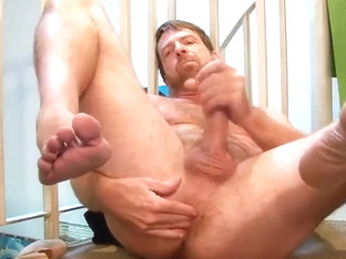 Handsome hairy guy plays with himself