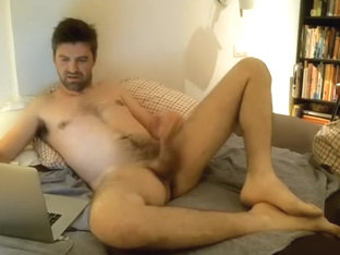 Handsome fagot is jerking off in a small room and memorializing himself on camera