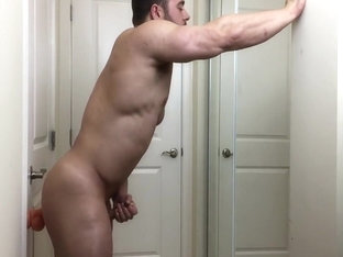 muscle stud jerks off with dildo