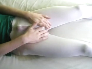 peeing in white pantyhose lying on the bed
