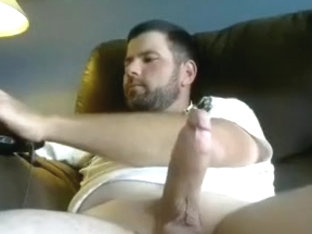 Enchanting guy is relaxing in his room and shooting himself on web cam