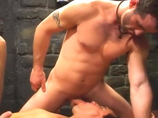 Stud Takes Two Big Hard Cocks In Dungeon