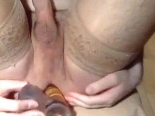 Wearing stockings and dildo in my ass