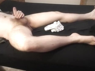 Stroke in briefs on the daybed
