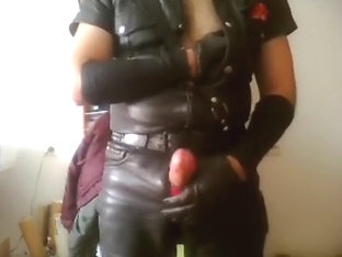jerking off and smokin' in full leather