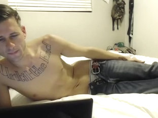 Handsome male is beating off in the bedroom and memorializing himself on camera