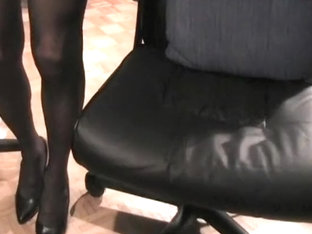 Crossdresser in black stockings stroking huge cock