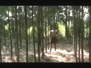 Cute asian lad alone in the forest