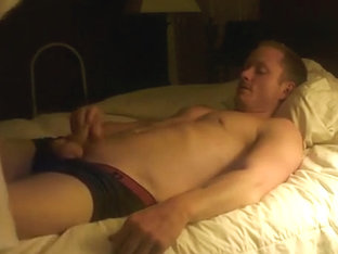 Ginger nude on bed, playing with dildo
