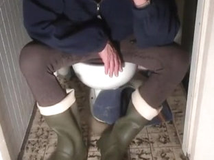 nlboots - lycra and green hunting boots on toilet