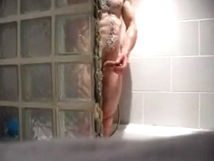 spy hunky guy during shower
