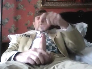 SUITED DAD DISCHARGES LOUD LOAD!