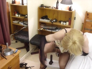 Sissy riding black dildo . Chastity stockings