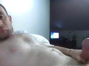 Attractive dude is having a good time in his room and filming himself on web cam